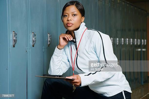 Sports coach in locker room, portrait