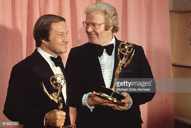 Sports commentator Jim McKay and Wide World Of Sport producer Roone Arledge pose backstage with their trophies at the 1972 Emmy Awards on May 6 1972...