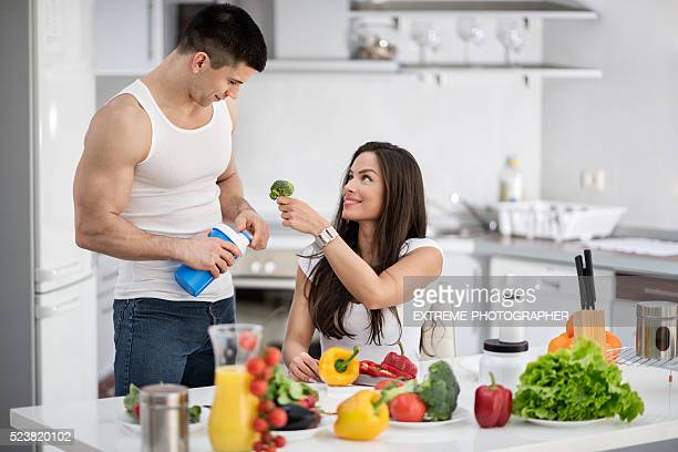 Sports couple in the kitchen