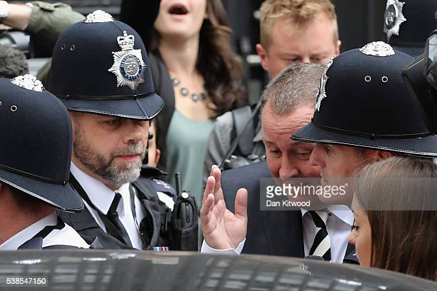 Sports Direct International founder Mike Ashley is escorted into a taxi by police as he leaves Portcullis House after attending a Parliamentary...