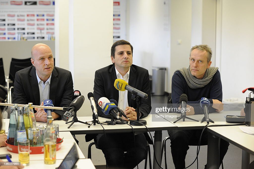 Sports director Dirk Dufner Rudi Raschke and Christian Streich new head coach of SC Freiburg attend a press conference at Badenova Stadium on...
