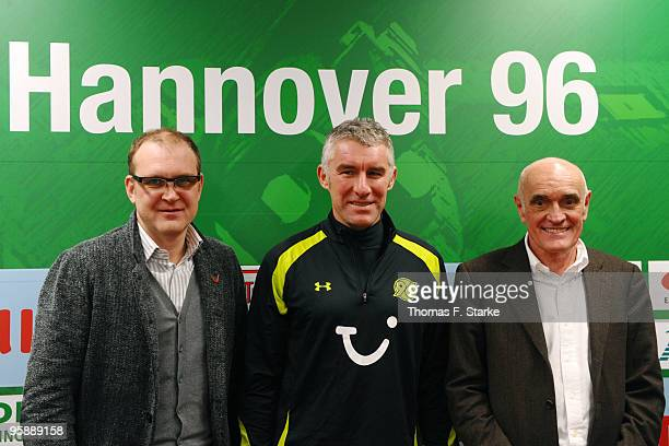 Sports director Joerg Schmadtke new head coach Mirko Slomka and president Martin Kind of Hannover 96 pose for photographers after the press...