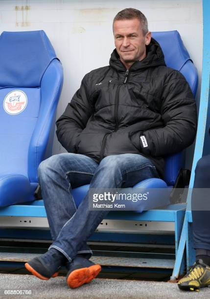 Sports director Mario Kallnik of Magdeburg looks on prior to the third league match between FC Hansa Rostock and 1FC Magdeburg at Ostseestadion on...