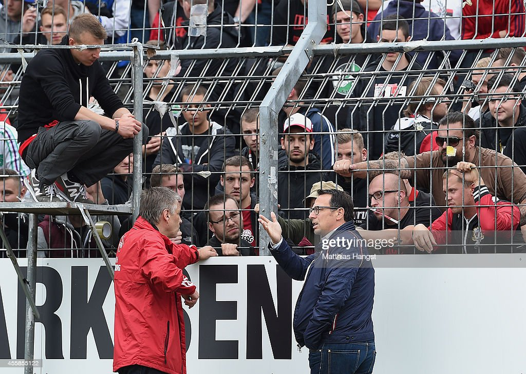 Sports director Martin Bader of Nuernberg speaks to the fans during the Second Bundesliga match between Karlsruher SC and 1 FC Nuernberg at Wildpark...