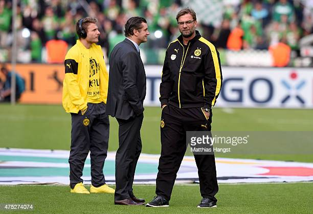 Sports Director Michael Zorc and head coach Juergen Klopp of Borussia Dortmund enjoy the atmosphere of the DFB Cup Final match between Borussia...