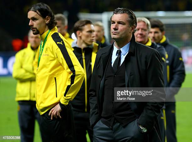 Sports director Michael Zorc of Dortmund looks dejected after loosing the DFB Cup Final match between Borussia Dortmund and VfL Wolfsburg at...