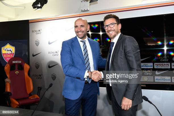 Sports director of AS Roma Ramon Rodriguez Verdejo Monchi and AS Roma's new head coach Eusebio Di Francesco shake hands as they pose for a photo...