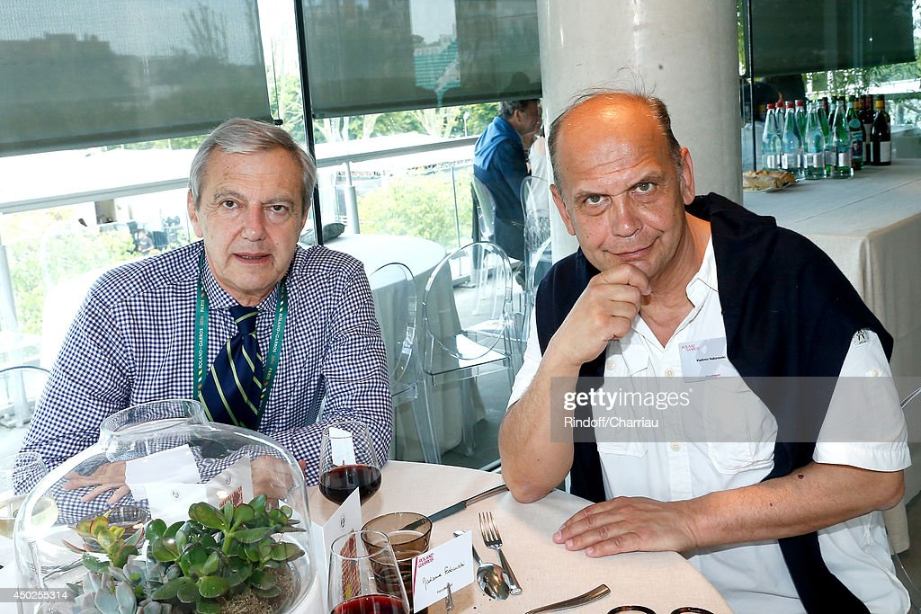 Sports director of France Televisions Daniel Bilalian and and writer Vladimir Fedorovski pose at France Television french chanels studio after she won the Roland Garros French Tennis Open 2014 - Day 14 on June 7, 2014 in Paris, France.