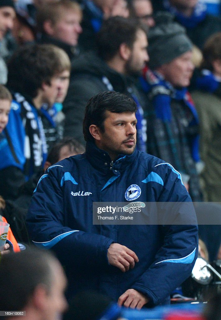 Sports director Samir Arabi of Bielefeld looks on from the main stand after being sent off the pitch by referee Michael Weiner during the Third League match between Arminia Bielefeld and Preussen Muenster at Schueco Arena on March 9, 2013 in Bielefeld, Germany.