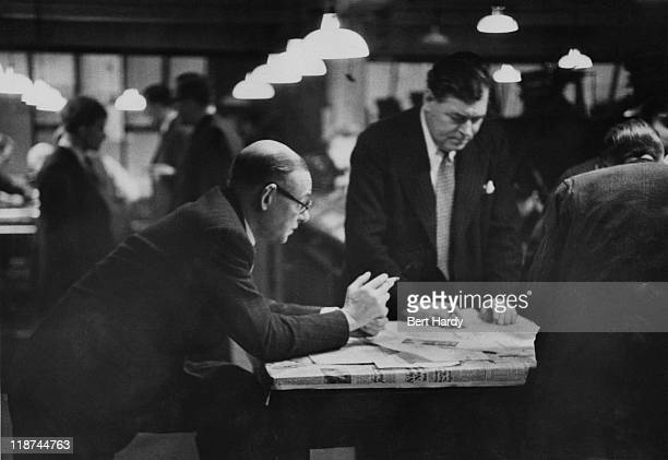 Sports Editor George Forrest at work on a Saturday afternoon in the newsroom at the offices of the News of The World April 1953 Original Publication...