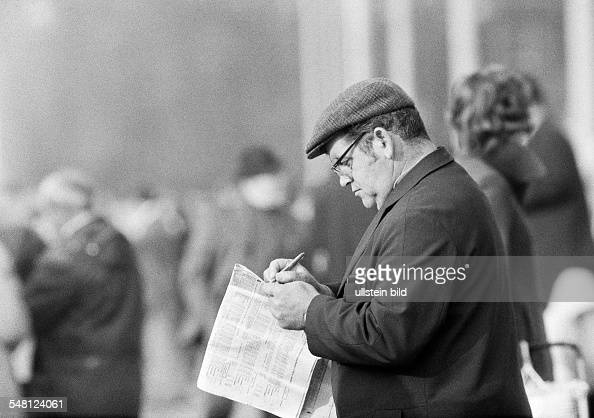 sports equestrianism racecourse Dinslaken trotting race 1973 horseracing bet man reads the racing sheet aged 50 to 60 years DDinslaken Lower Rhine...