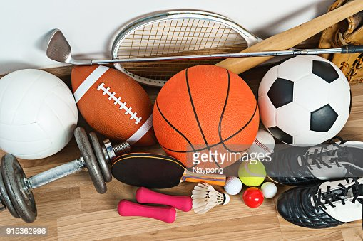 Sports Equipment on wooden background : Stock Photo