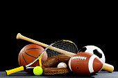Misc. Sports equipment on a black background with copy space above