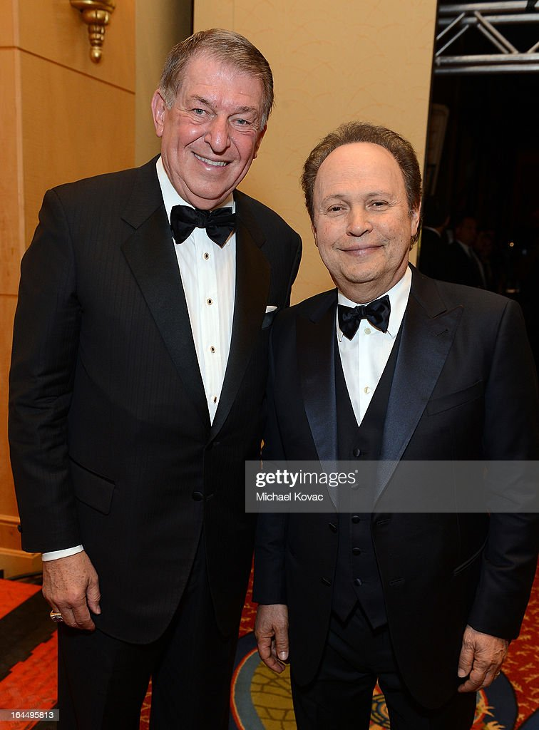 Sports executive Jerry Colangelo and actor Billy Crystal with Moet & Chandon at Celebrity Fight Night XIX at JW Marriott Desert Ridge Resort & Spa on March 23, 2013 in Phoenix, Arizona.