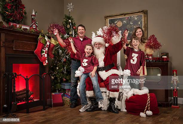 Sports Family Cheers with Santa Claus in Living Room
