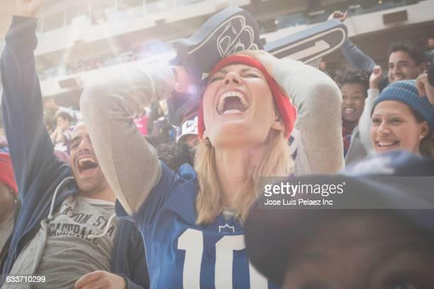 Sports fan cheering in stadium