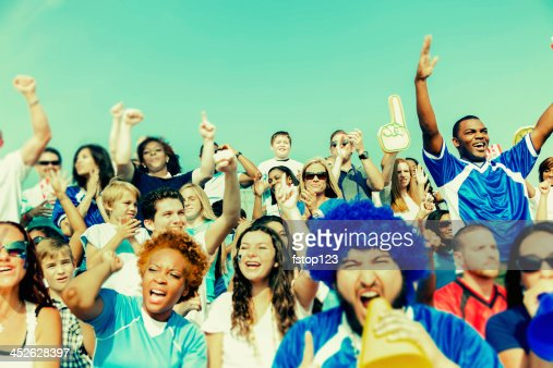 Sports: Fans cheer for their team during local sporting event.
