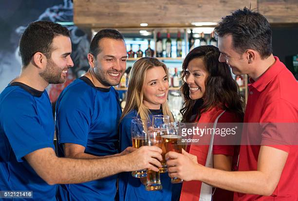Sports fans making a toast at the pub