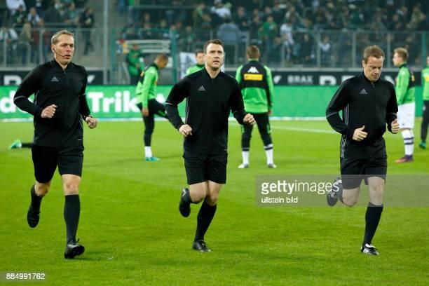 sports football Bundesliga 2016/2017 Borussia Moenchengladbach versus Eintracht Frankfurt 00 Stadium Borussia Park match officials fltr assistant...