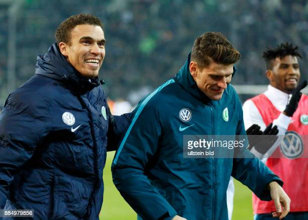 sports football Bundesliga 2016/2017 Borussia Moenchengladbach vs VfL Wolfsburg 12 Stadium Borussia Park coach Valerien Ismael L and scorer of the...