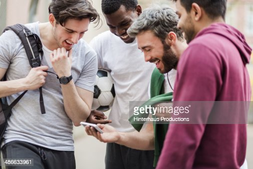 Sports Guys With Smart Phone Having Fun : Stock Photo