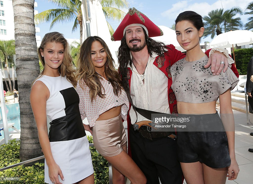 Sports Illustrated Cover Models Nina Agdal, Chrissy Teigen and Lily Aldridge pose with Captain Morgan as Captain Morgan White Rum celebrates Sports Illustrated Swimsuit's 50th anniversary at Fontainebleau Miami Beach on February 19, 2014 in Miami Beach, Florida.