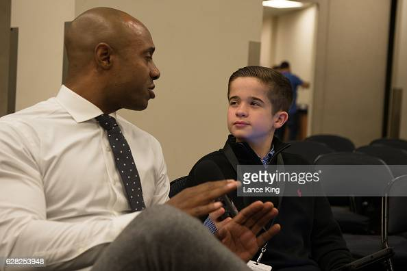 Sports Illustrated Kids reporter Max Bonnstetter interviews ESPN college basketball analyst Jay Williams during the Jimmy V Classic at Madison Square...