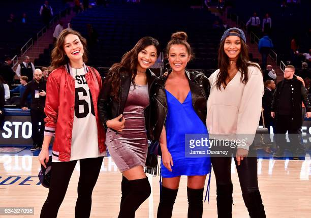 Sports Illustrated Swimsuit 2017 Rookie Class models Myla Dalbesio Danielle Herrington Mia Kang and Lais Ribeiro pose on the court before the Los...