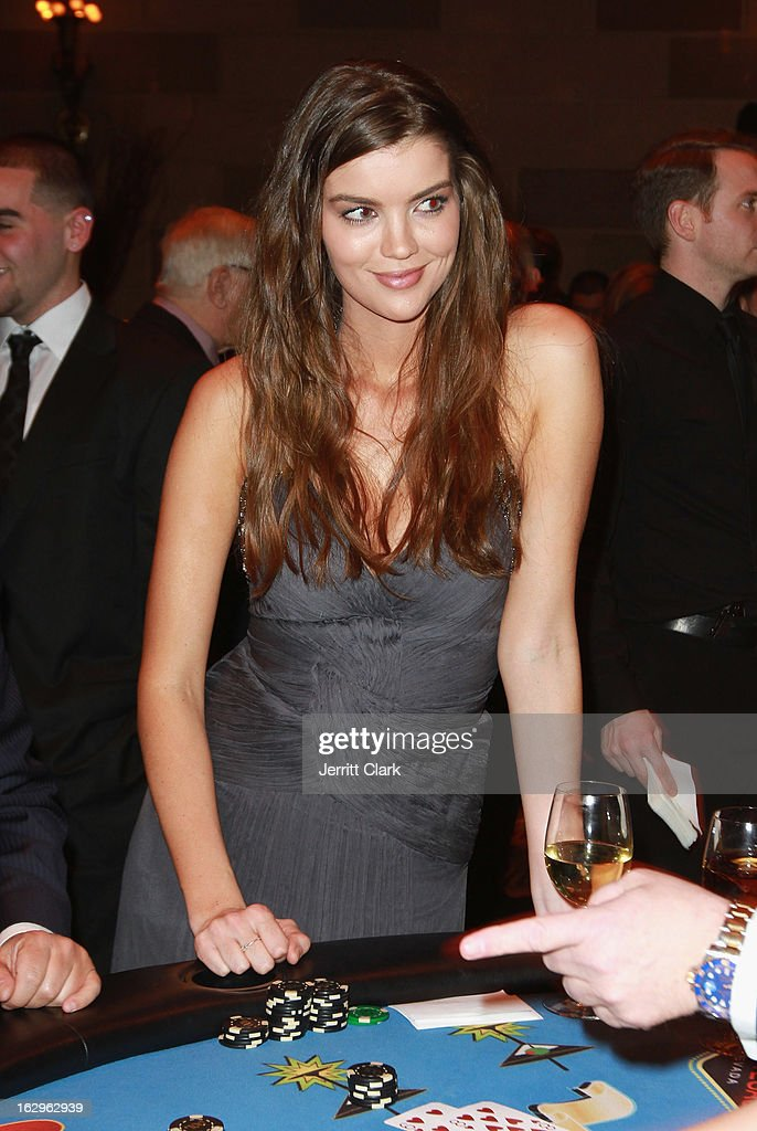 Sports Illustrated swimsuit mode Natasha Barnard deals at a blackjack tabel at the 2013 New York Rangers Casino Night at Gotham Hall on March 1, 2013 in New York City.