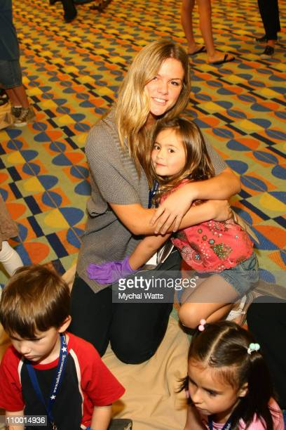 Sports Illustrated Swimsuit model Brooklyn Decker poses with children of wounded Heroes during a Camp COPE session on December 3 2007 in Orlando...