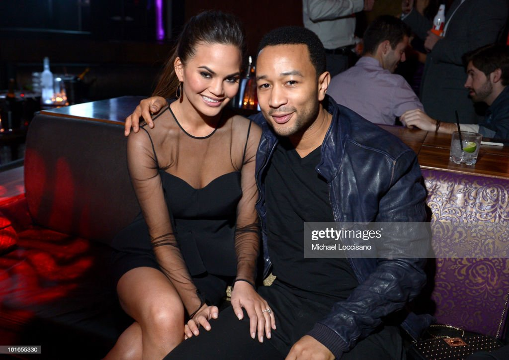 Sports Illustrated swimsuit model Chrissy Teigen and musician John Legend attend SI Swimsuit on Location at the Marquee Nightclub at The Cosmopolitan of Las Vegas on February 13, 2013 in Las Vegas, Nevada.