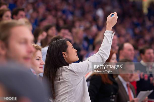 Sports Illustrated Swimsuit Model Jarah Mariano watches the New York Rangers game against the New Jersey Devils in Game One of the Eastern Conference...