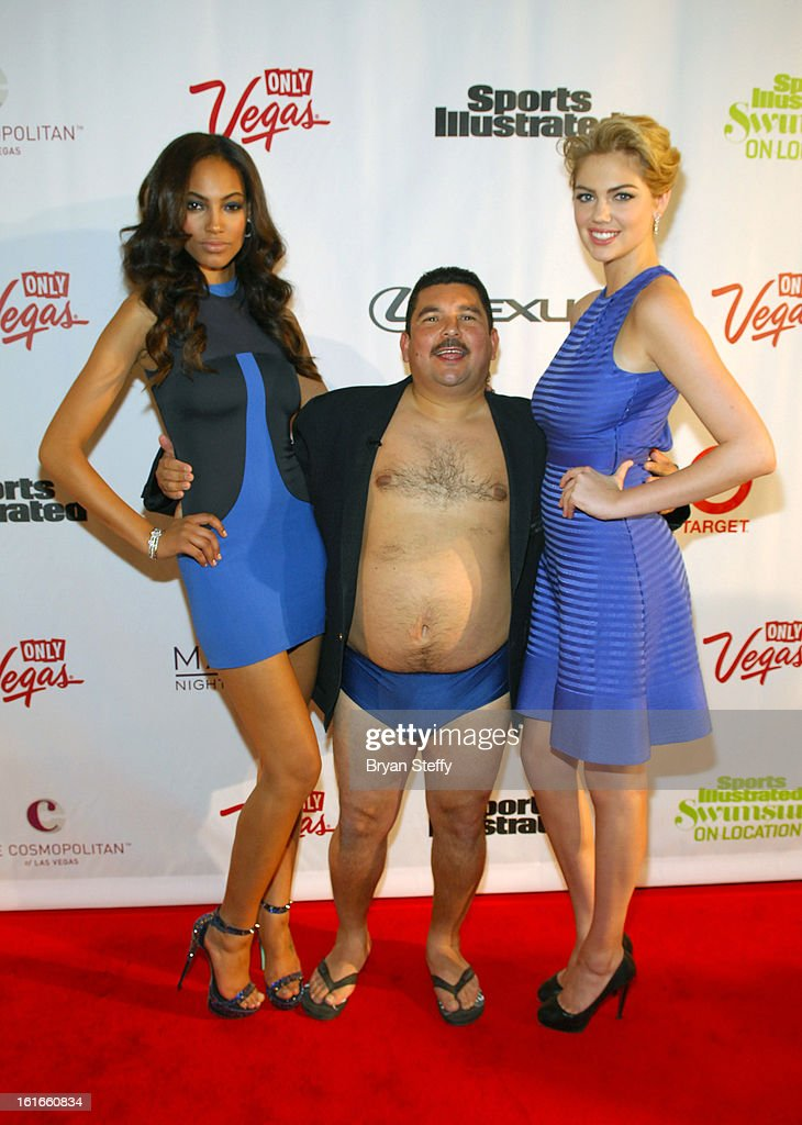 Sports Illustrated swimsuit models Ariel Meredith (L) and Kate Upton (R) with TV personality Guillermo at SI Swimsuit on Location at the Marquee Nightclub at The Cosmopolitan of Las Vegas on February 13, 2013 in Las Vegas, Nevada.