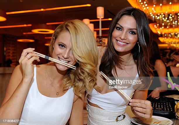 Sports Illustrated swimsuit models Kate Bock and Alyssa Miller appear at Andrea's at Encore Las Vegas on June 28 2013 in Las Vegas Nevada