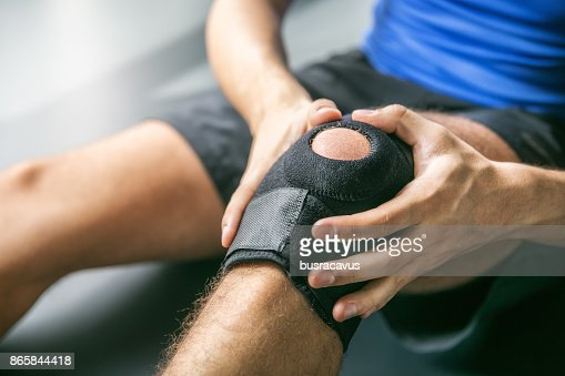 Sports injuries, bandaged knee : Foto stock
