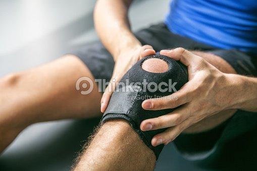 Sports injuries, bandaged knee : Stock Photo