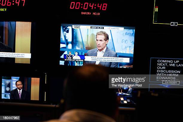 Sports journalist and television personality Skip Bayless can be seen on television screens in the control room during the live filming of First Take...