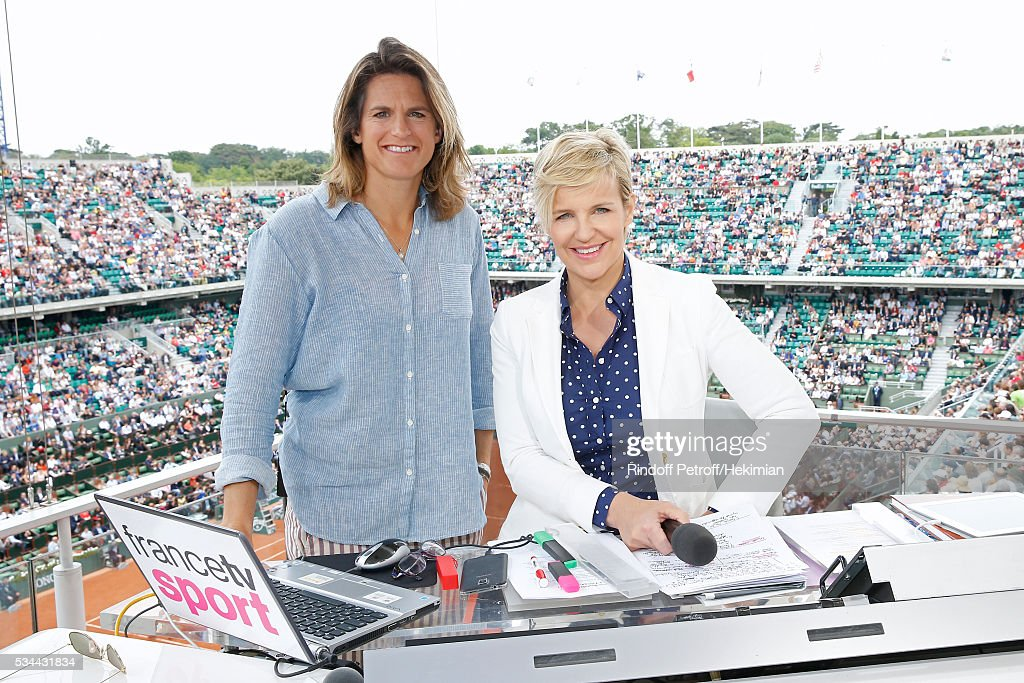 Sports journalist Celine Geraud (R) poses with Presenter of Roland Garros, Amelie Mauresmo (L) at France Television french chanel studio during the 2016 French Tennis Open - Day Three at Roland Garros on May 24, 2016 in Paris, France.