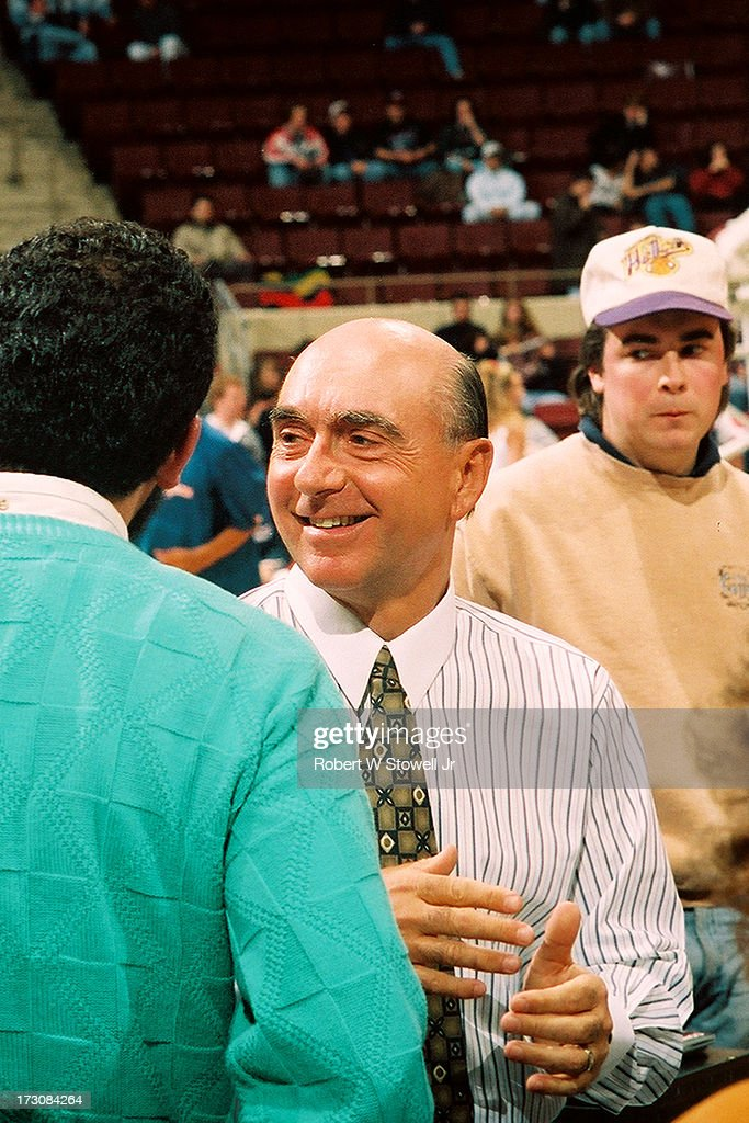 Sports journalist <a gi-track='captionPersonalityLinkClicked' href=/galleries/search?phrase=Dick+Vitale&family=editorial&specificpeople=730924 ng-click='$event.stopPropagation()'>Dick Vitale</a> (right) of ESPN talks with several people before a game, Hartford, Connecticut, 1995.
