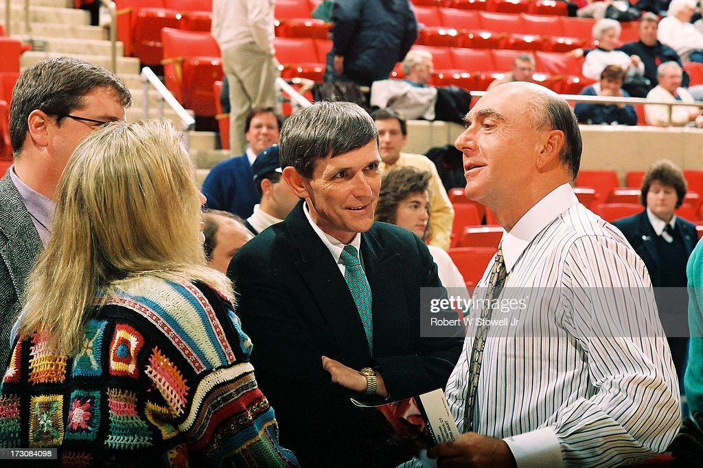 Sports journalist <a gi-track='captionPersonalityLinkClicked' href=/galleries/search?phrase=Dick+Vitale&family=editorial&specificpeople=730924 ng-click='$event.stopPropagation()'>Dick Vitale</a> (right) of ESPN talks with several people, among them University of Connecticut Associate Athletic Director Tim Tolokan (green tie), before a game, Hartford, Connecticut, 1995.