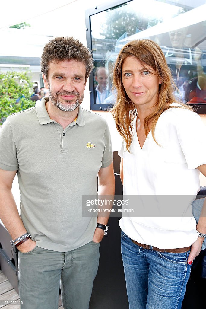 Sports journalist Herve Mathoux and his wife Mary attend the 2016 French Tennis Open - Day Six at Roland Garros on May 27, 2016 in Paris, France.