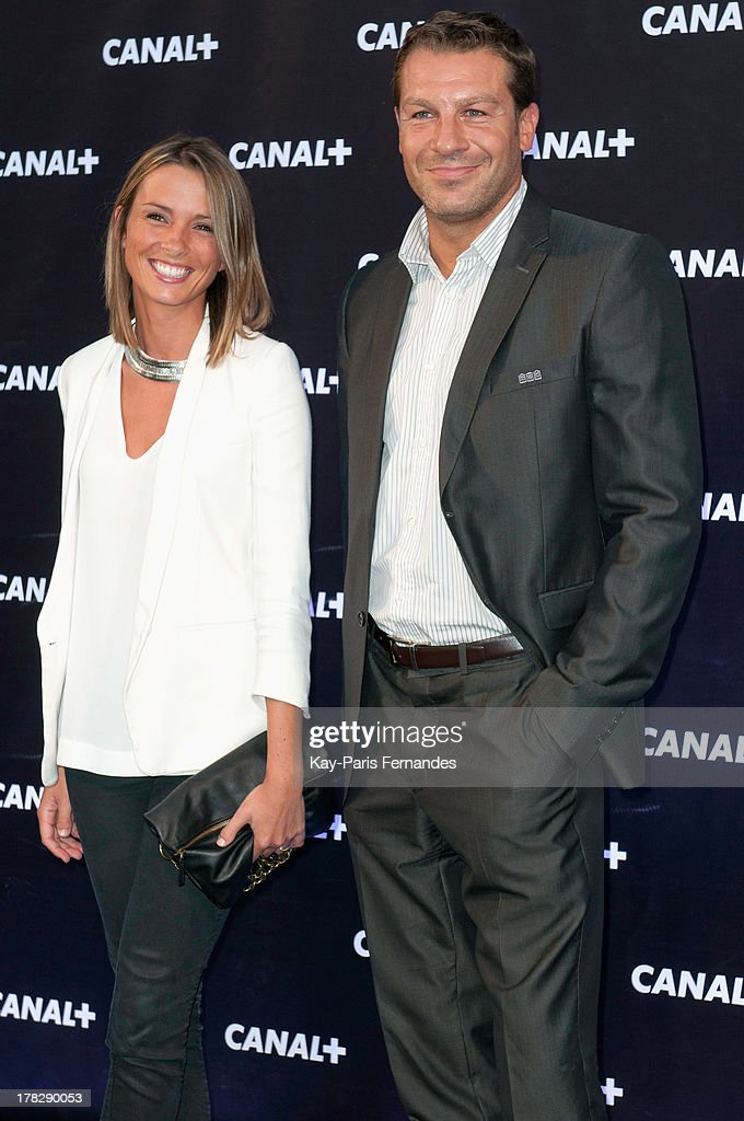 Sports journalist Isabelle Ithurburu (L) and Rugby union player Thomas Lombard (r), at the 'Rentree De Canal +' photocall at Porte De Versailles on August 28, 2013 in Paris, France.