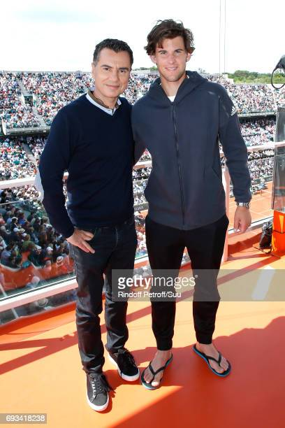 Sports Journalist Laurent Luyat and Austrian Tennis player Dominic Thiem pose at France Television french chanel studio during the 2017 French Tennis...