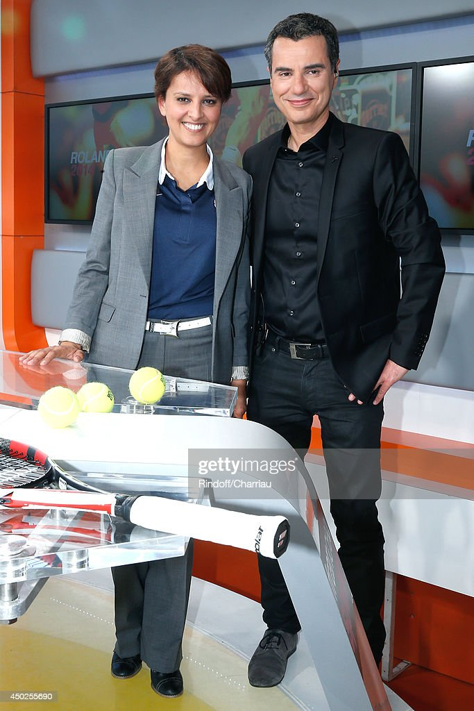 Sports journalist Laurent Luyat (R) and Minister of Women's Rights, the City and the Youth and Sports Najat Vallaud-Belkacem pose at France Television french chanels studio after she won the Roland Garros French Tennis Open 2014 - Day 14 on June 7, 2014 in Paris, France.