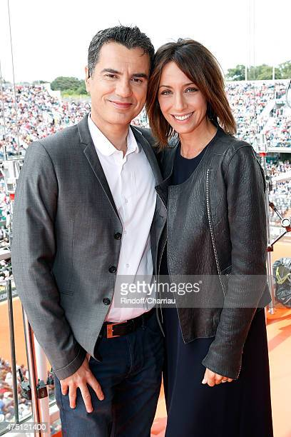 Sports journalist Laurent Luyat and TV Host Virginie Guilhaume pose at France Television french chanel studio during the 2015 Roland Garros French...