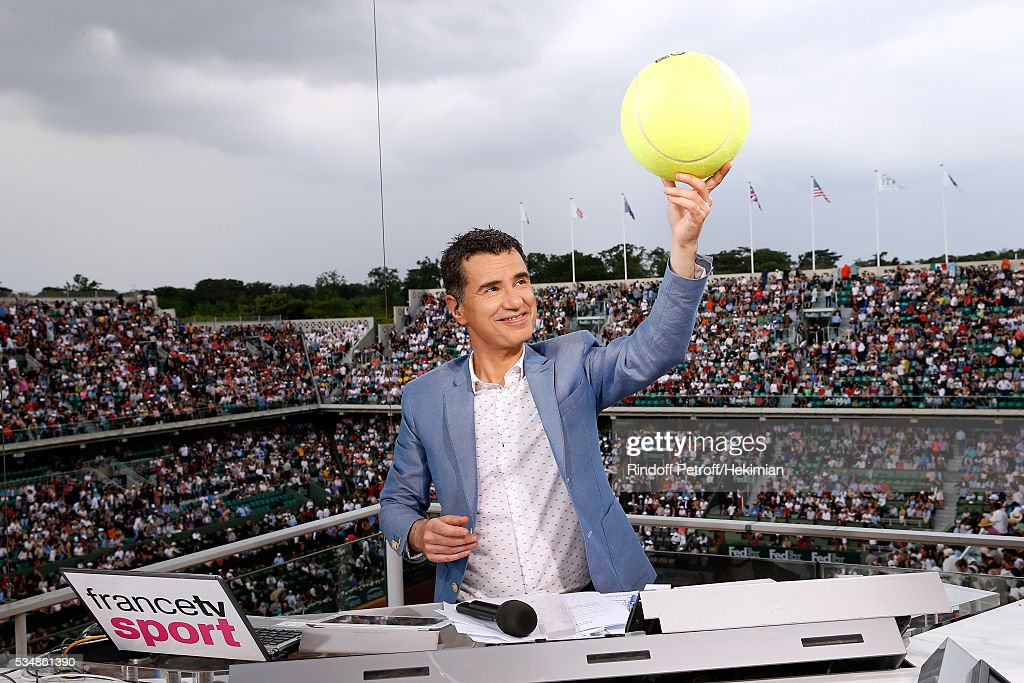Sports journalist Laurent Luyat plays with a tennis ball at France Television french chanel studio during Day Seven of the 2016 French Tennis Open at Roland Garros on May 28, 2016 in Paris, France.