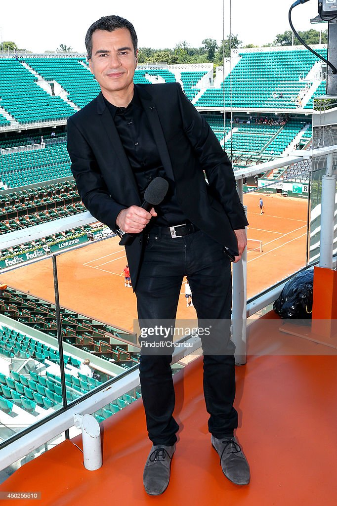 Sports journalist Laurent Luyat poses at France Television french chanels studio after she won the Roland Garros French Tennis Open 2014 - Day 14 on June 7, 2014 in Paris, France.