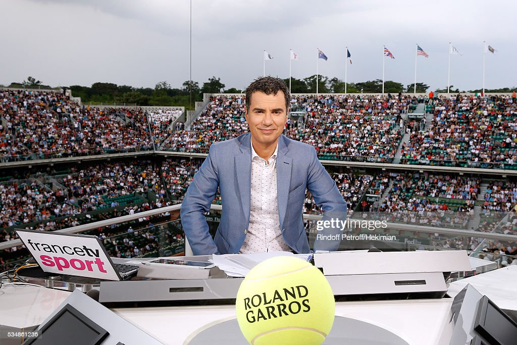 Sports journalist Laurent Luyat poses at France Television french chanel studio during Day Seven of the 2016 French Tennis Open at Roland Garros on May 28, 2016 in Paris, France.