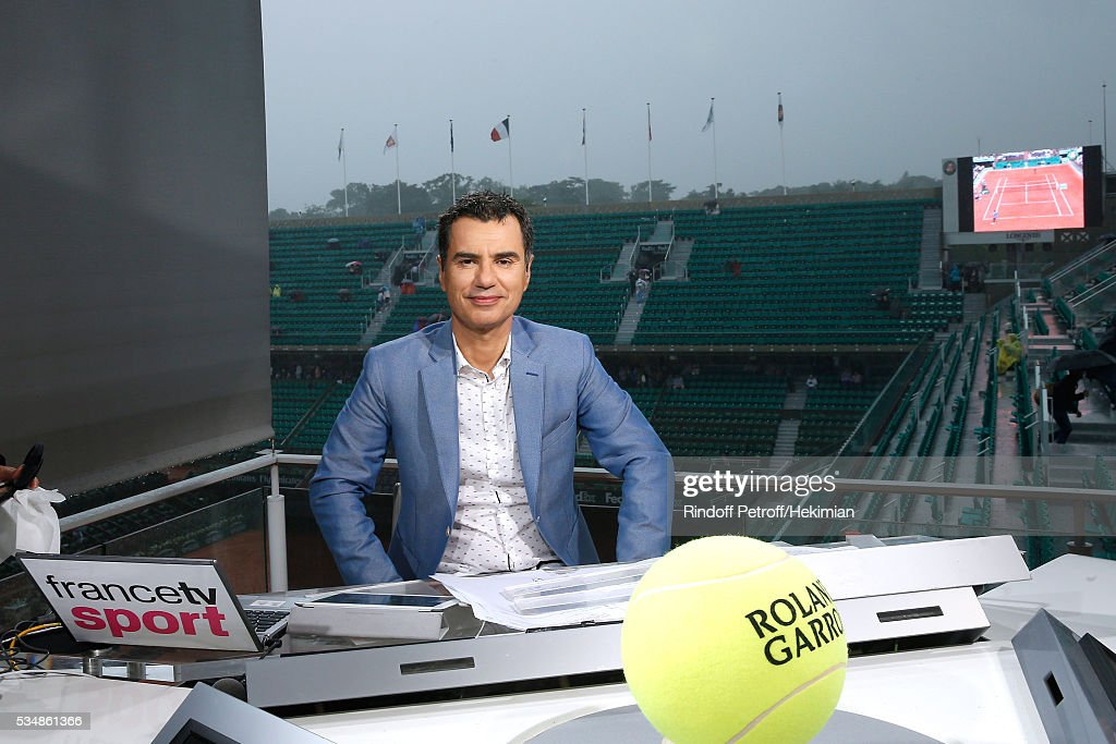 Sports journalist Laurent Luyat poses during a big storm at France Television french chanel studio during Day Seven of the 2016 French Tennis Open at Roland Garros on May 28, 2016 in Paris, France.