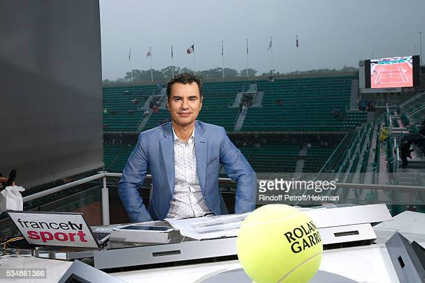 Sports journalist Laurent Luyat poses during a big storm at France Television french chanel studio during Day Seven of the 2016 French Tennis Open at...